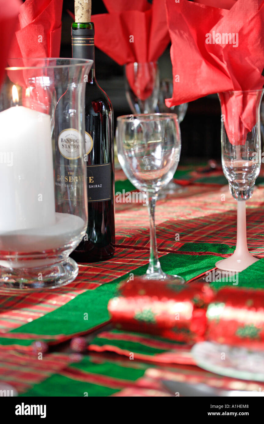 Christmas table and place settings in reds and greens & Christmas table and place settings in reds and greens Stock Photo ...