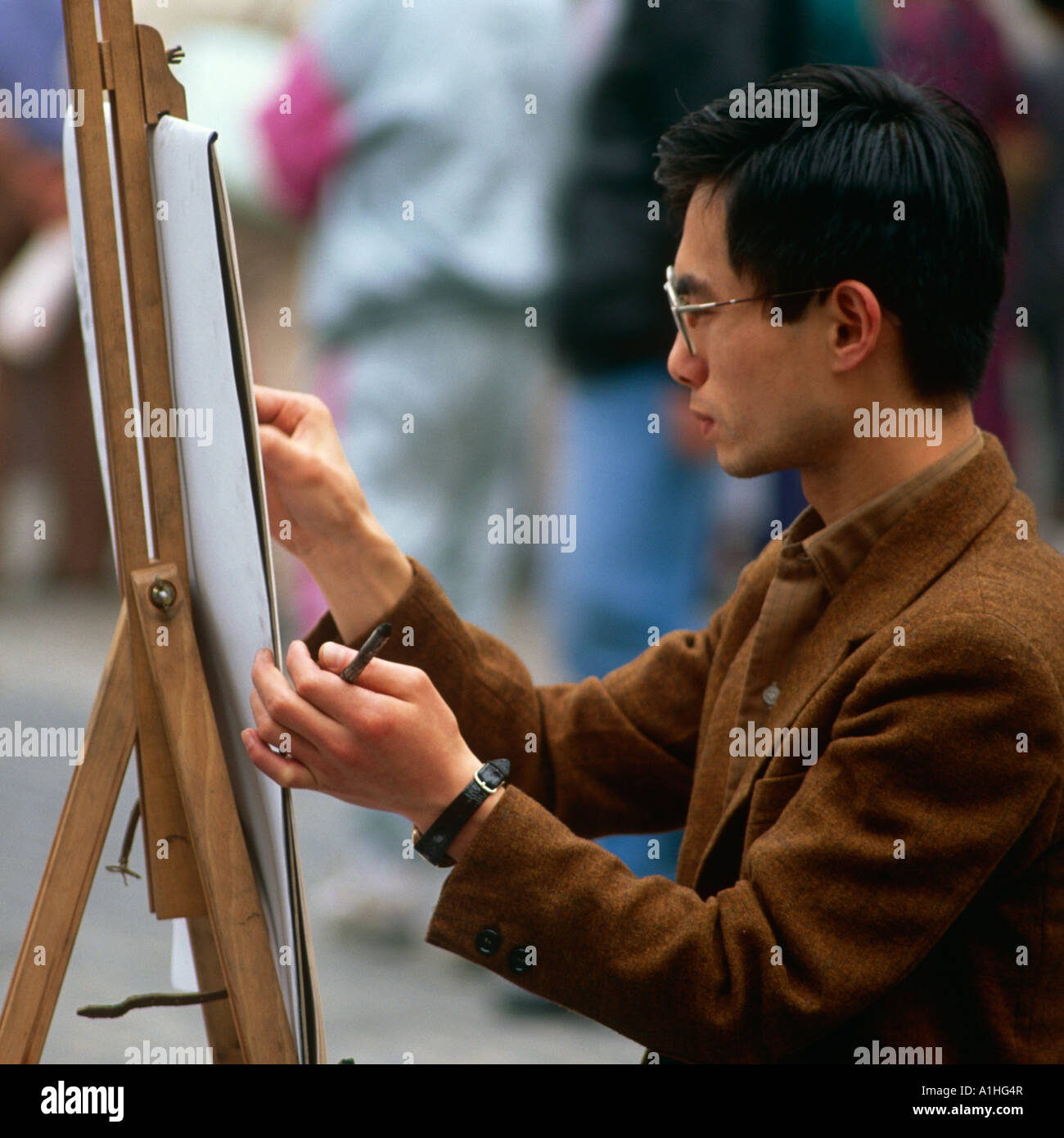 Artist Painting Tourists At The Piatza Covent Garden West End London UK Stock Photo