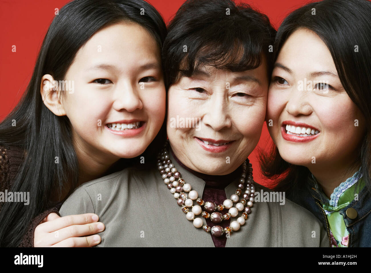 Portrait of a grandmother and her granddaughter smiling - Stock Image