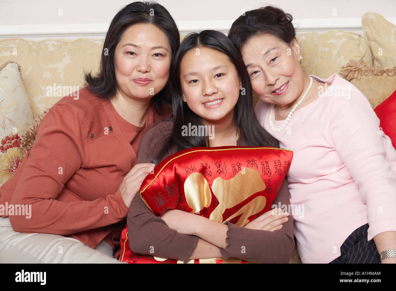 Portrait of a girl with her mother and her grandmother - Stock Image