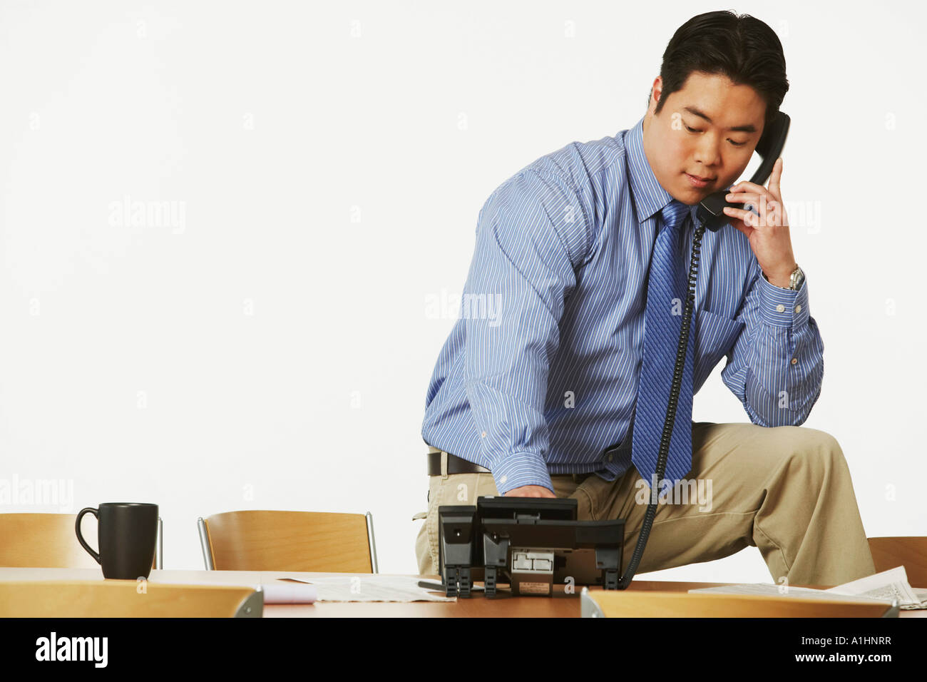 Close-up of a businessman using the telephone - Stock Image