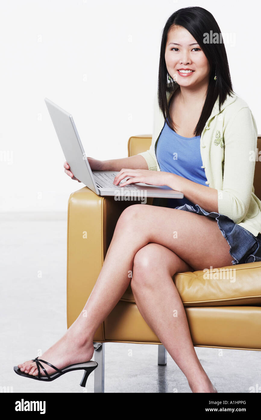 Portrait of a young woman using a laptop Stock Photo