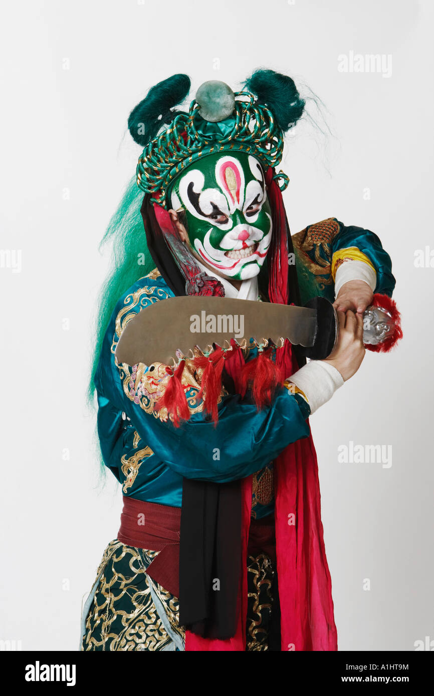 Close-up of a male Chinese opera performer holding a sword - Stock Image