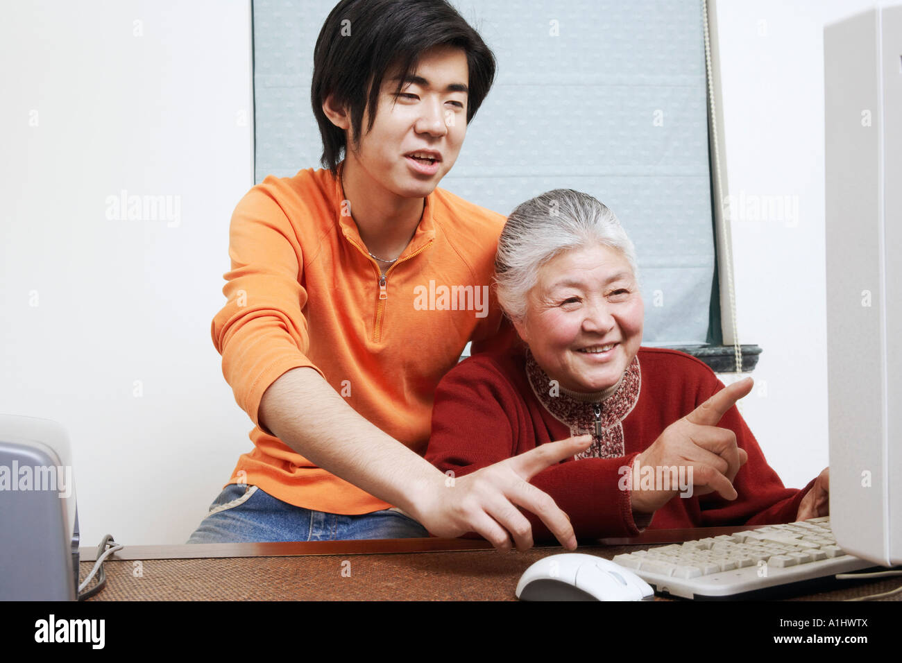 Close-up of a grandmother and her grandson using a computer - Stock Image