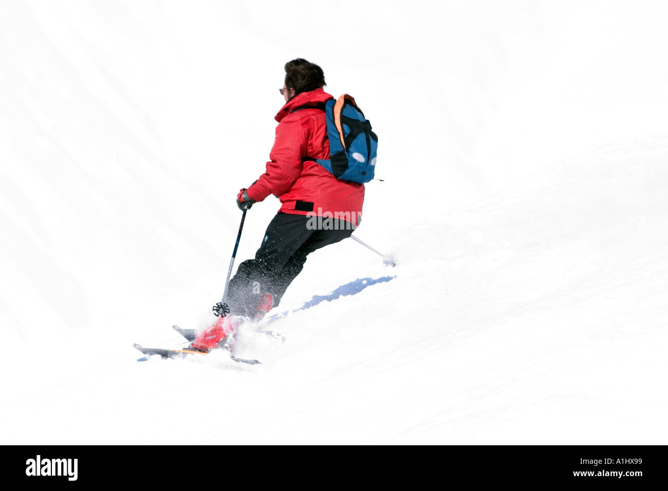 enjoying the powder snow through on a winter day in grand bornand France - Stock Image