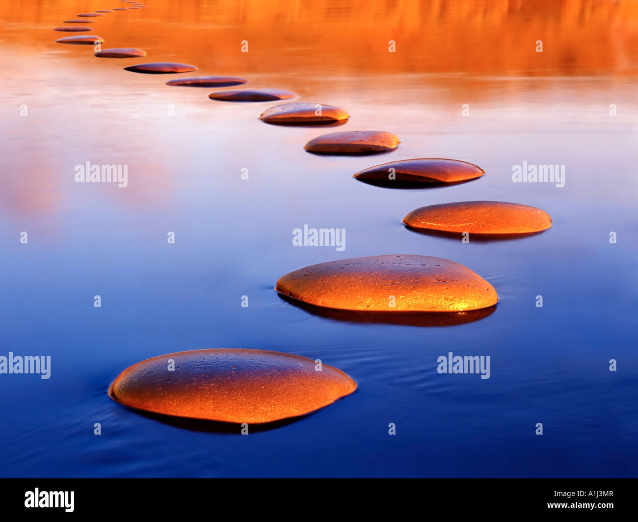 Stepping stones provide a safe passage through deep water - Stock Image