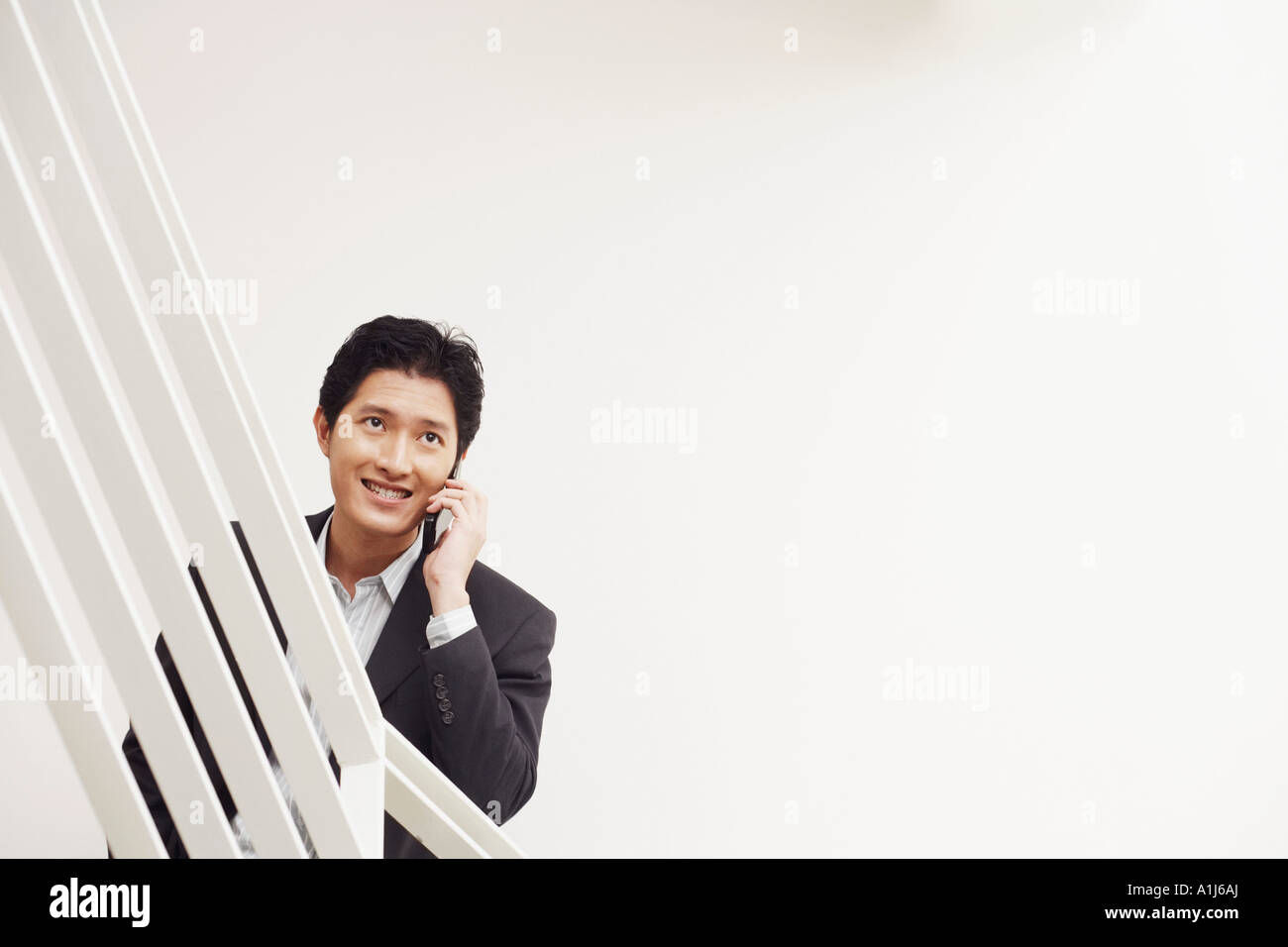 Businessman talking on a mobile phone Stock Photo