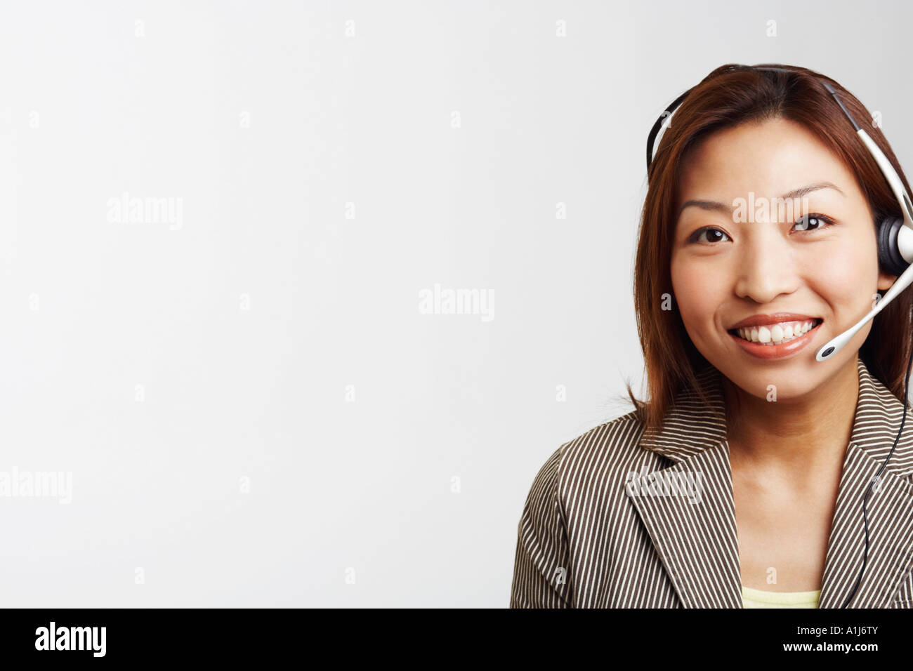 Portrait of a businesswoman wearing a headset and smiling Stock Photo