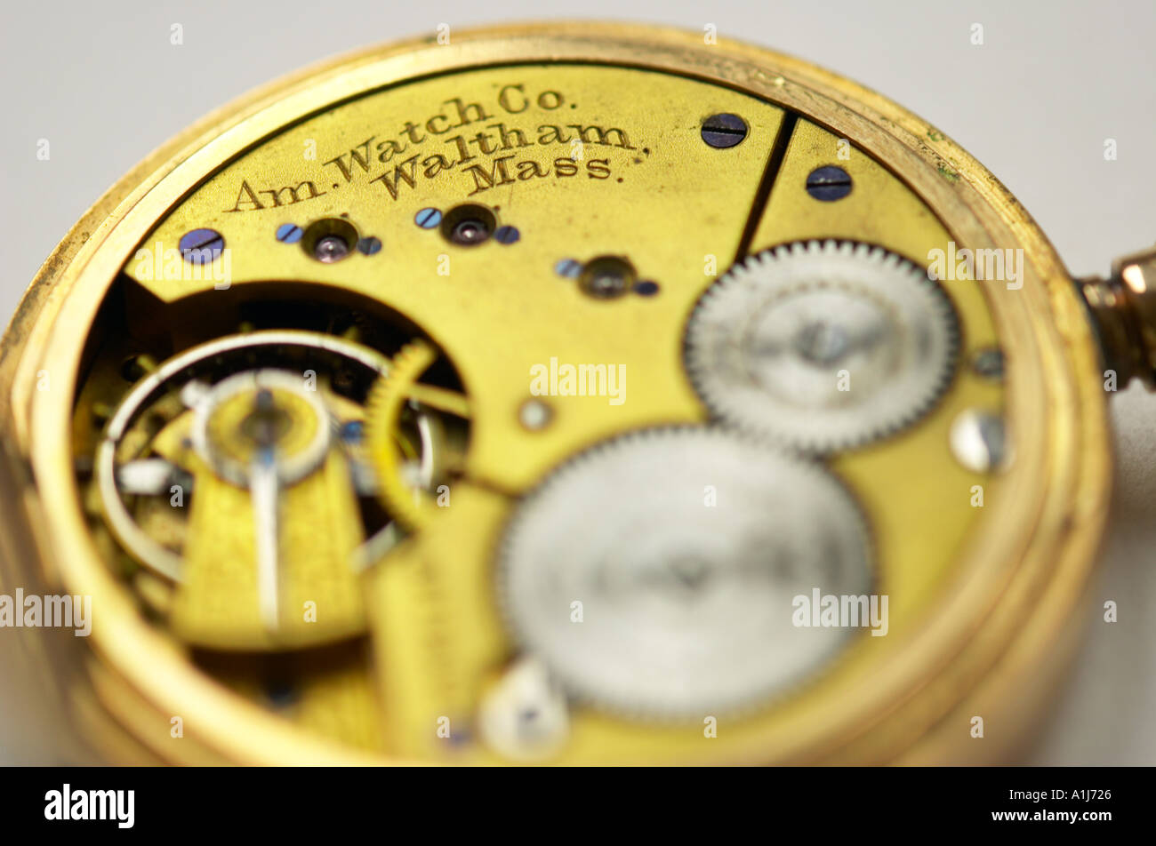 Close up of the clockwork mechanism of an old pocket watch - Stock Image