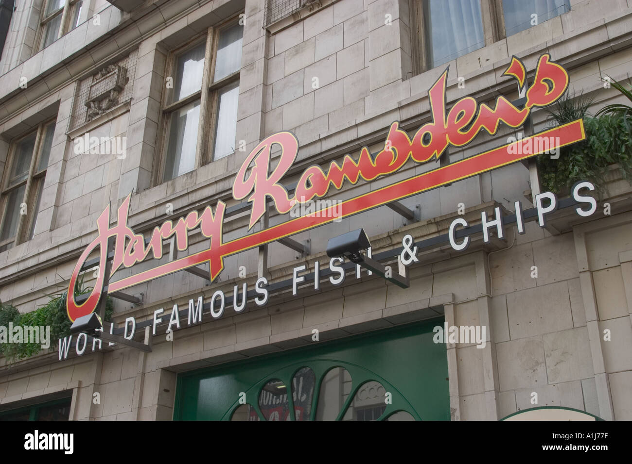 Harry Ramsden famous fish and chips sign in Soho London UK Stock Photo
