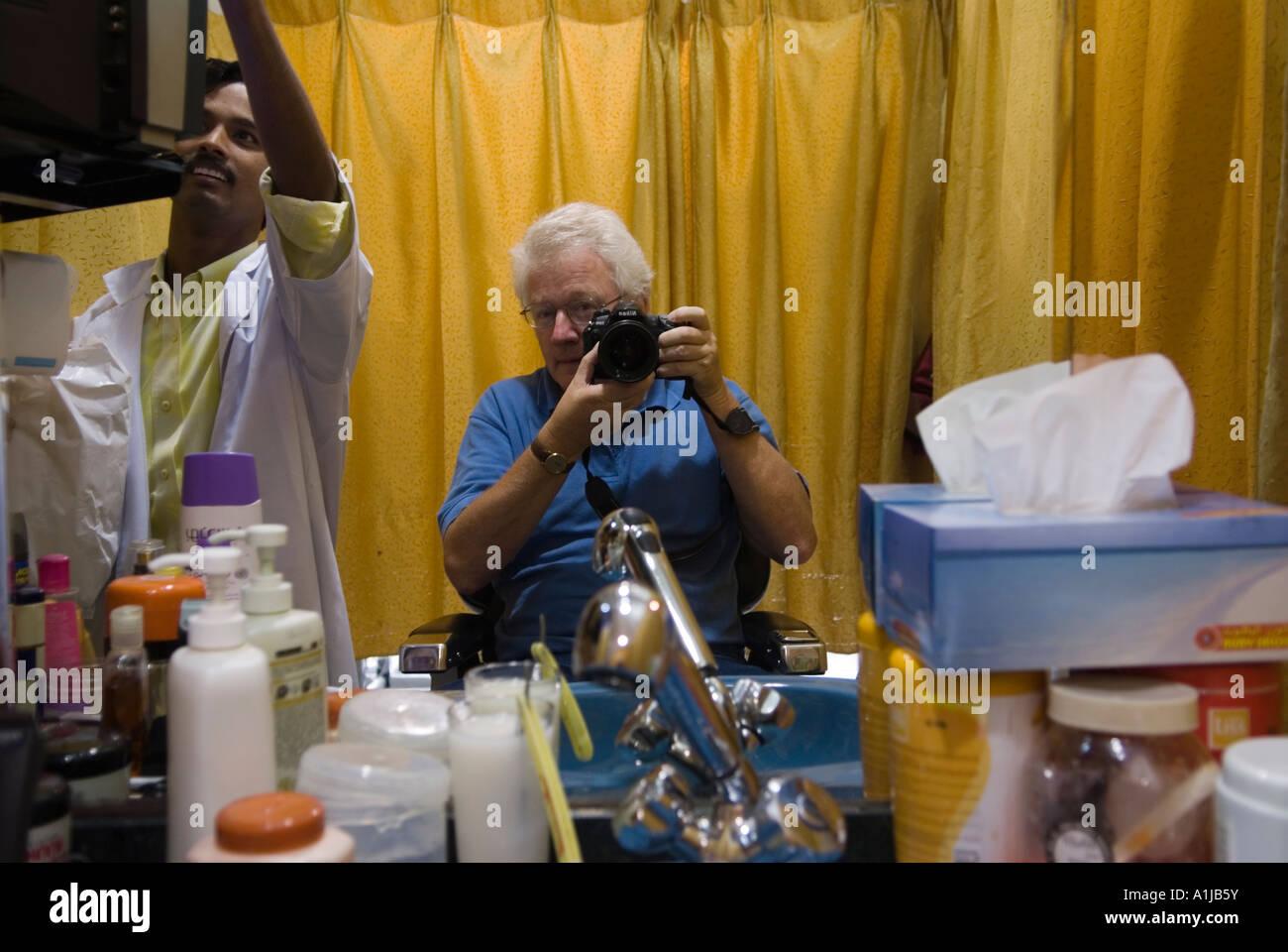 Abu Dhabi United Arab Emirates UAE Homer Sykes having a hair cut - Stock Image