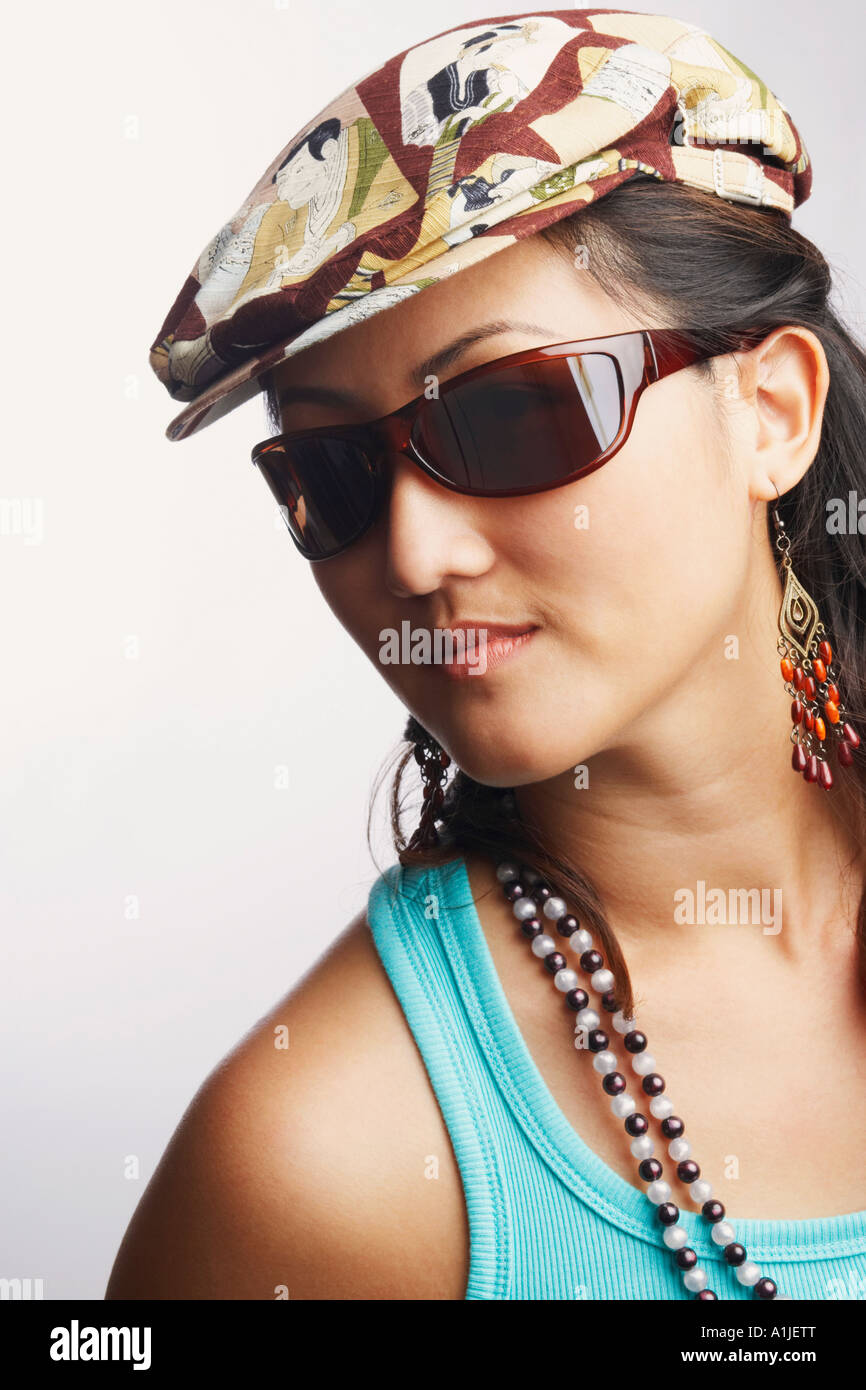 Portrait of a young woman wearing sunglasses - Stock Image