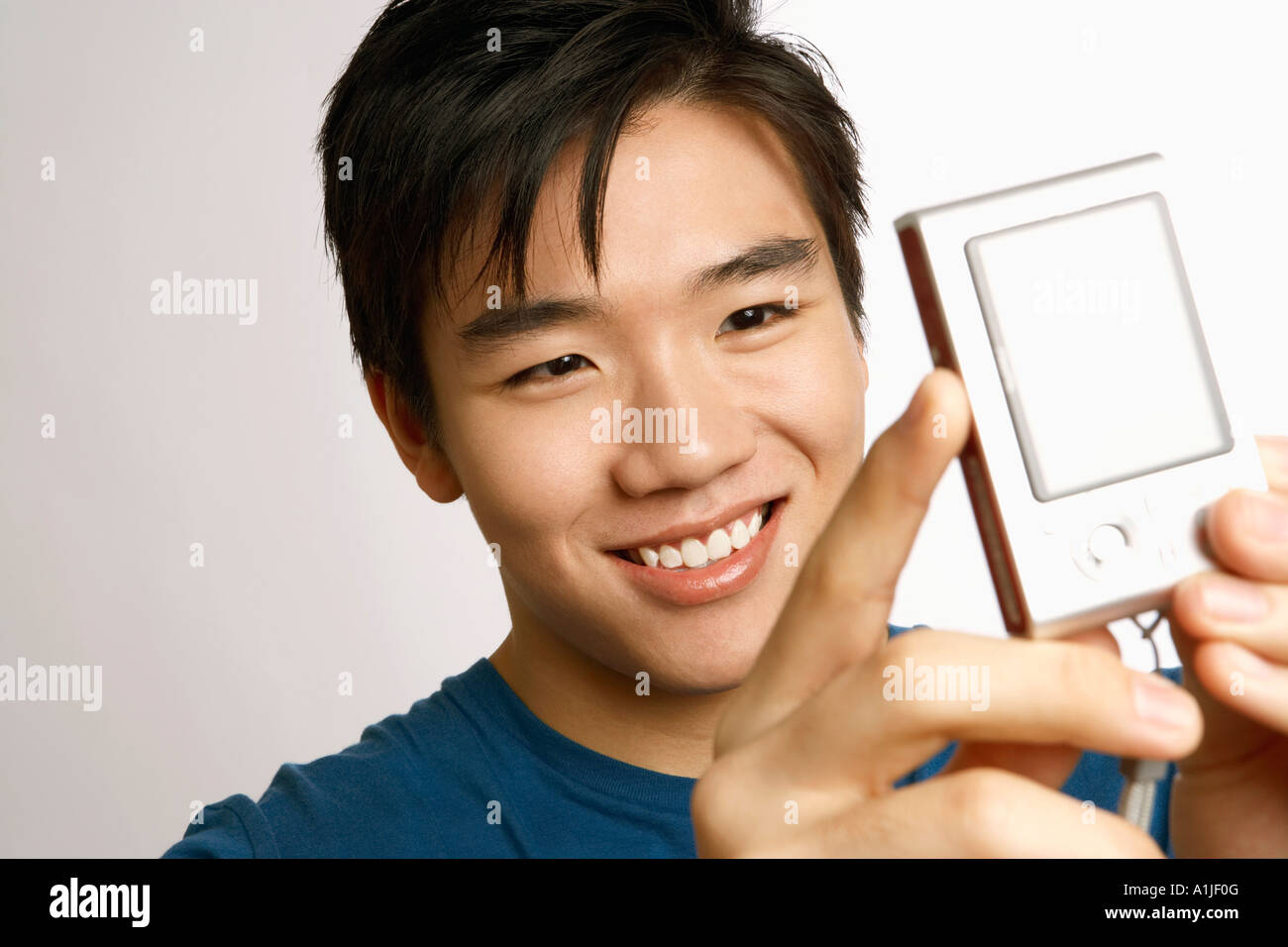 Close-up of a young man taking a picture of himself - Stock Image