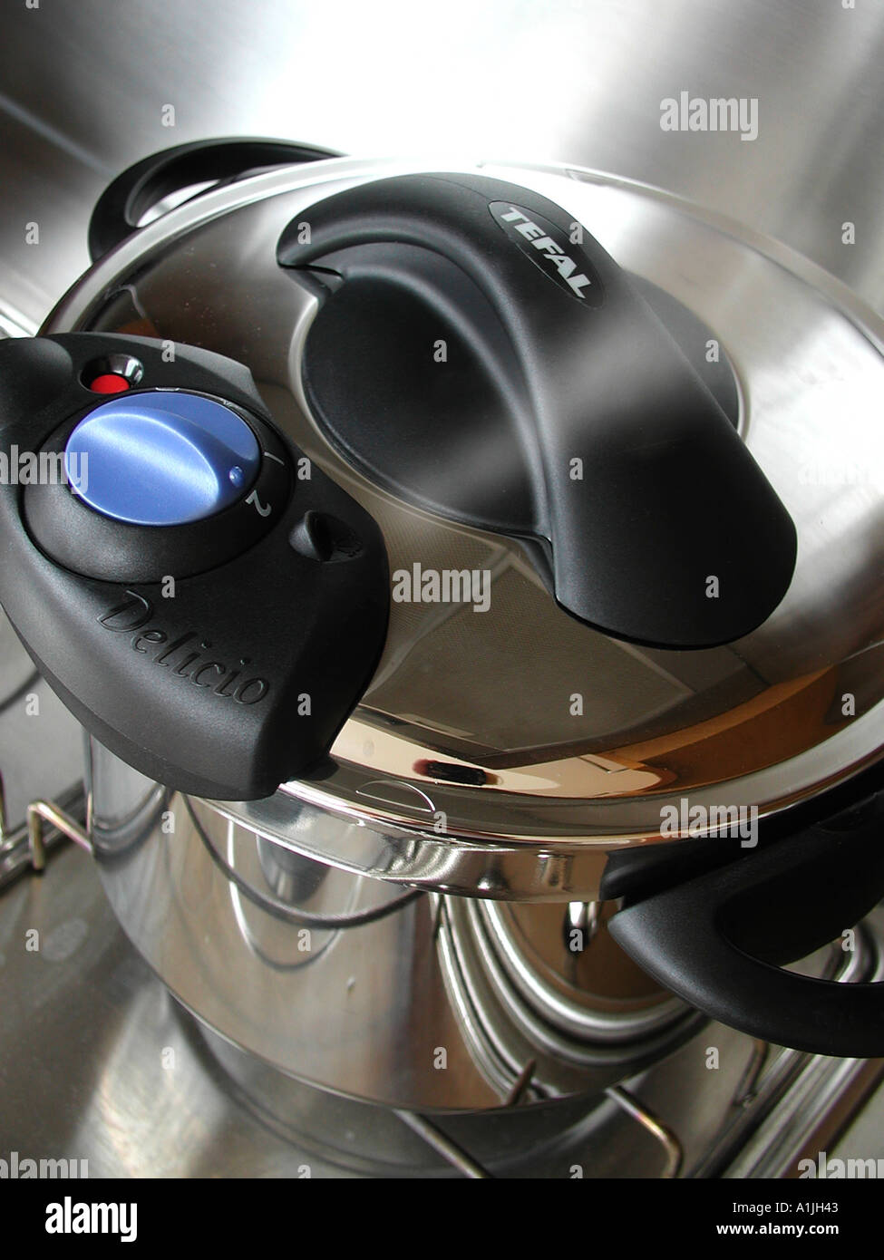 Using a pressure cooker - Stock Image