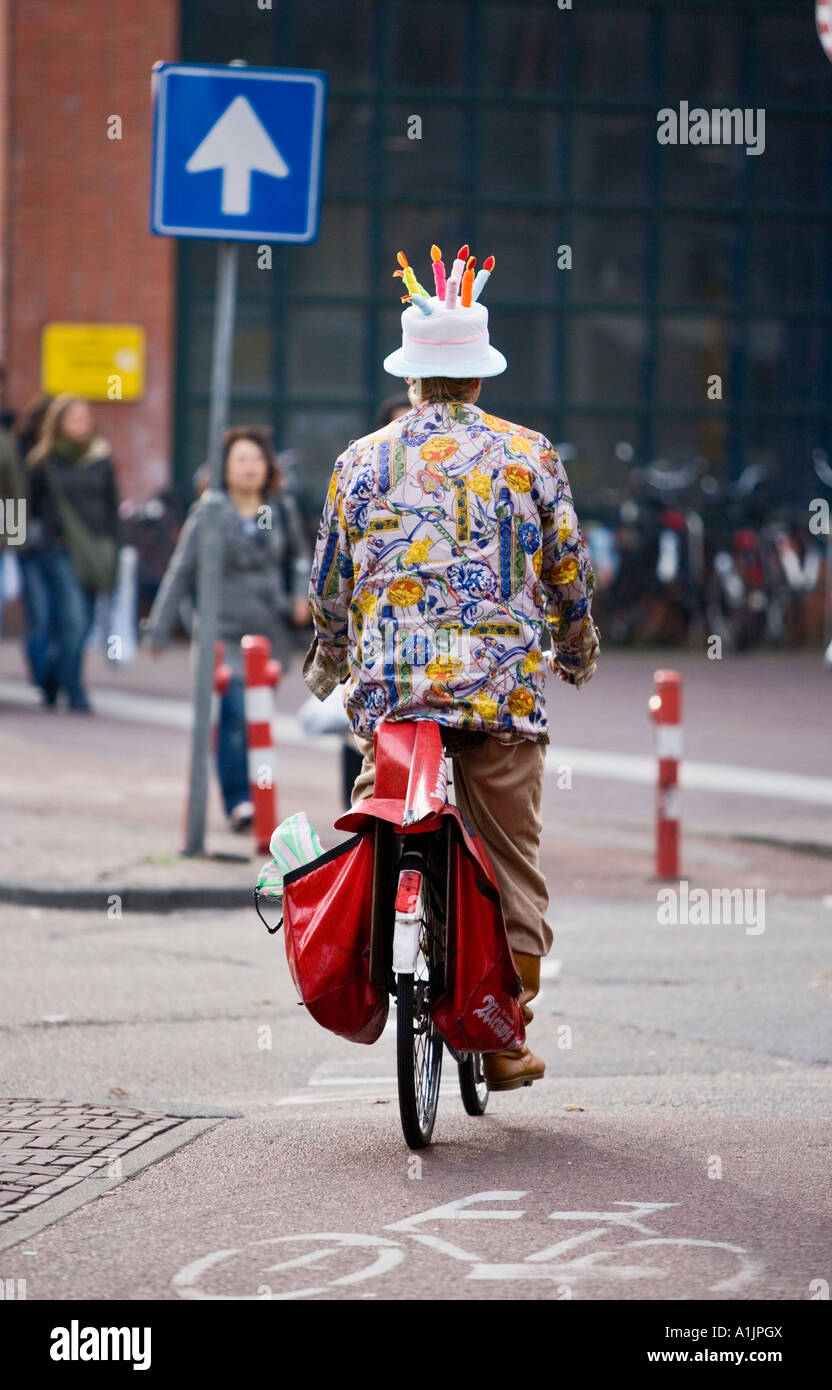 Amsterdam Cyclist Wearing A Birthday Cake Hat With Candles