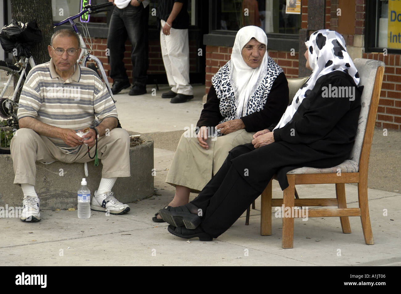 Two Older Women Wearing Hijabs Talk On Sidewalk Arab International Festival 2004 Dearborn Michigan USA the city Stock Photo