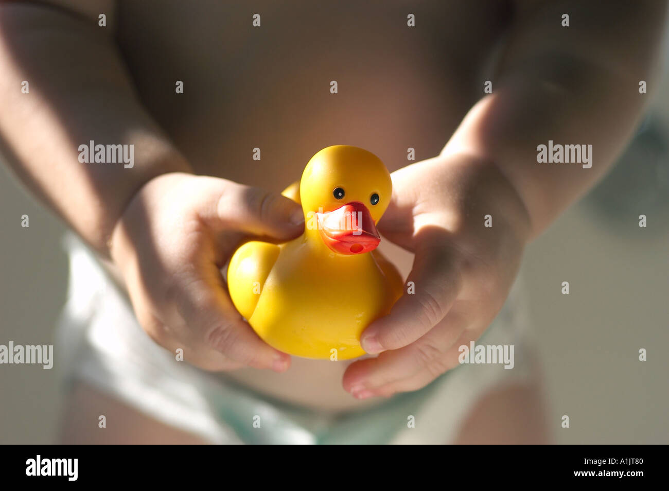 Closeup Baby Holding Duck Toy Stock Photos & Closeup Baby Holding ...