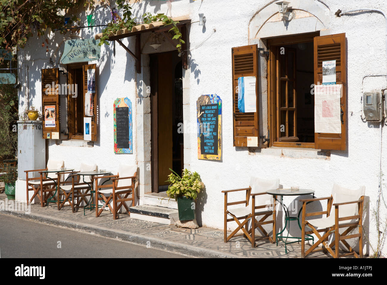 Greek taverna on the main street, Kardamyli,The Mani peninsula, Peloponnese, Greece - Stock Image