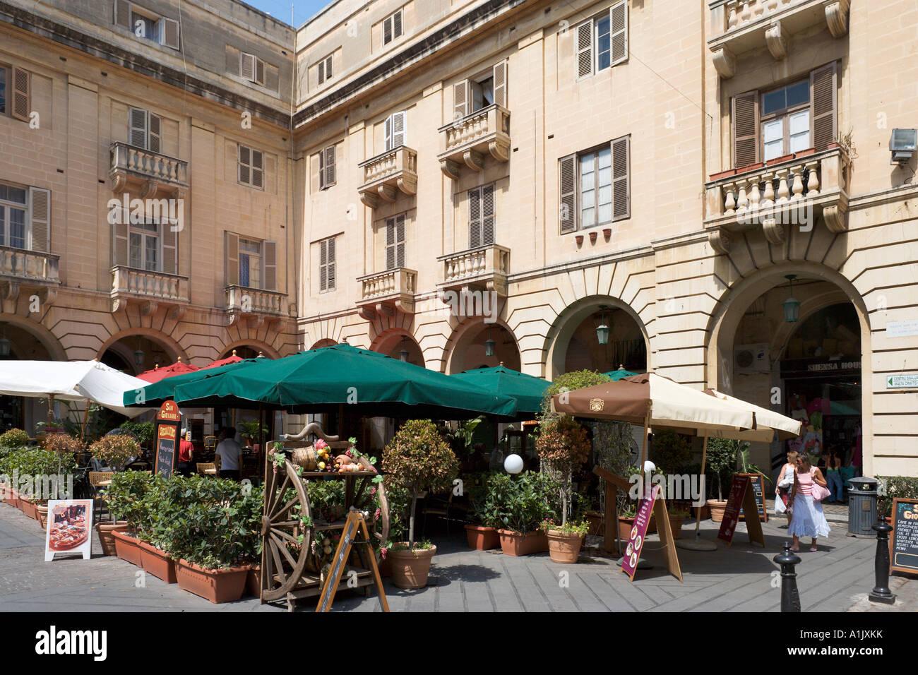 Restaurant outside St John's Co Cathedral, St John's Square, Valletta, Malta - Stock Image