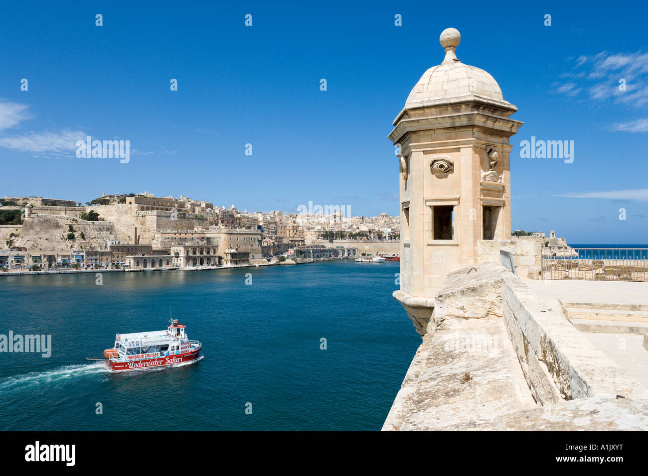 Captain Morgan Harbour Cruise Boat and View of Valletta and Grand Harbour from Senglea, Valletta, Malta - Stock Image