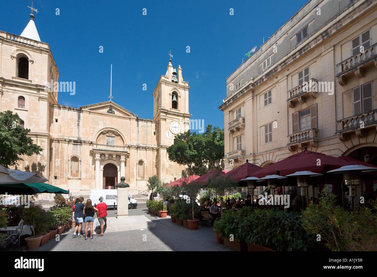 Restaurant and St John's Co Cathedral, St John's Square, Valletta, Malta - Stock Image