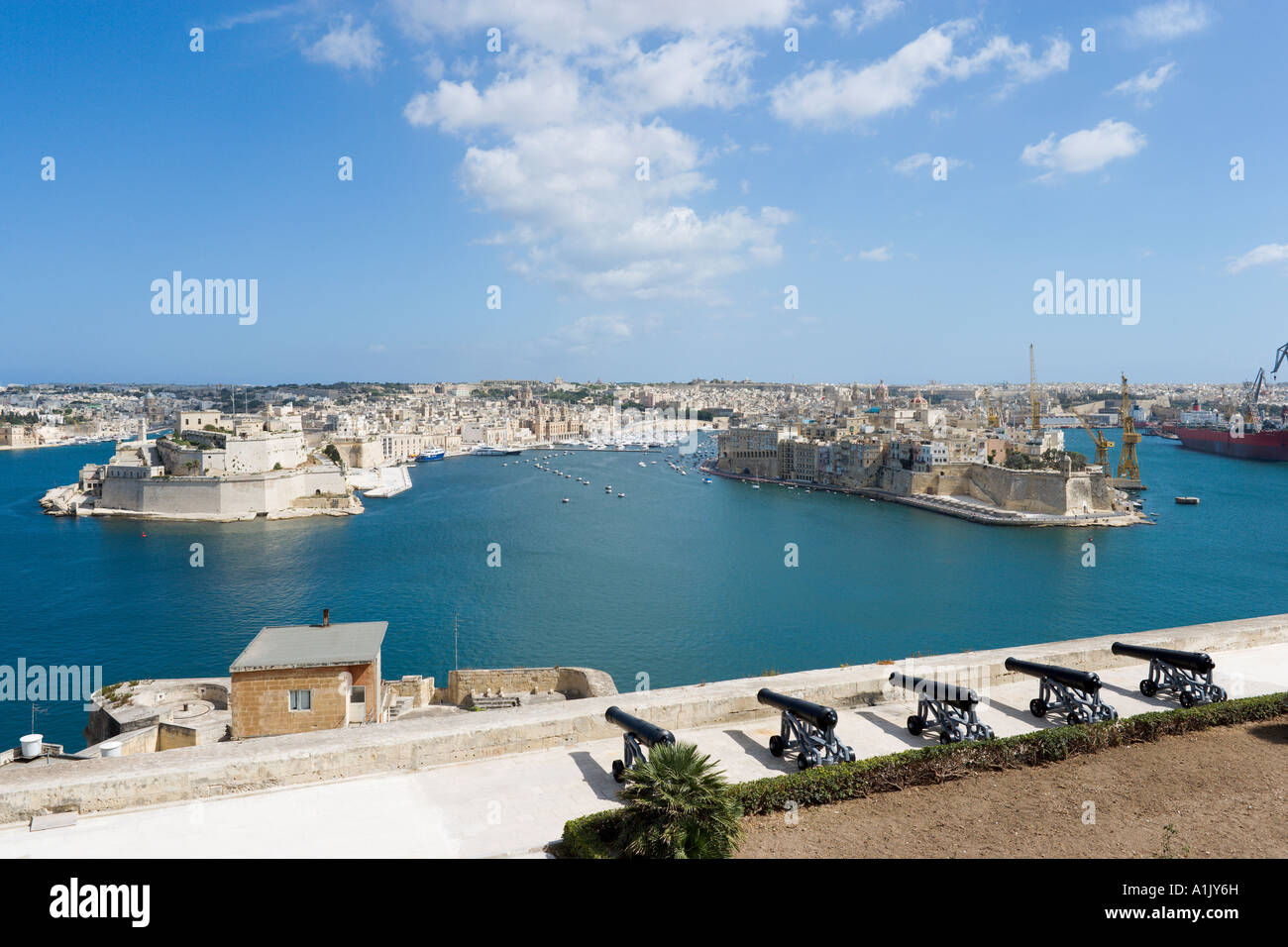 View over Grand Harbour, Vittoriosa and Fort St Angelo from Upper Barracca Gardens, Valletta, Malta - Stock Image