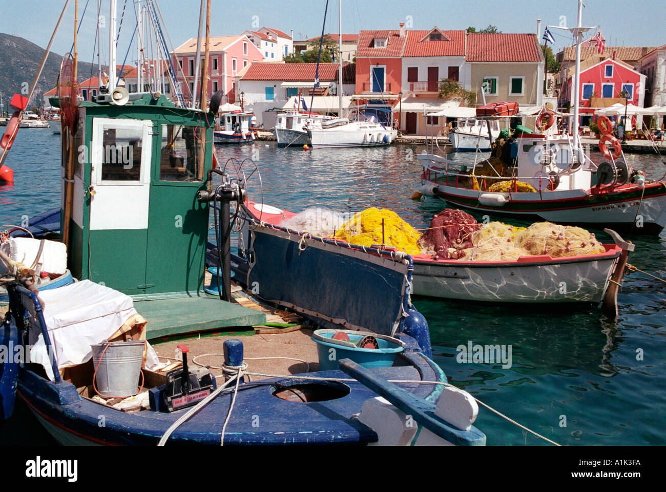 Fishing boats in harbour at northern village of Fiscardo on Kefalonia an Ionian Island. - Stock Image