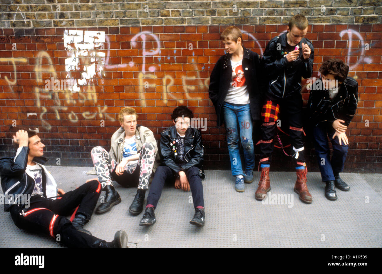 Group of young punk kids glue sniffing  in London. - Stock Image