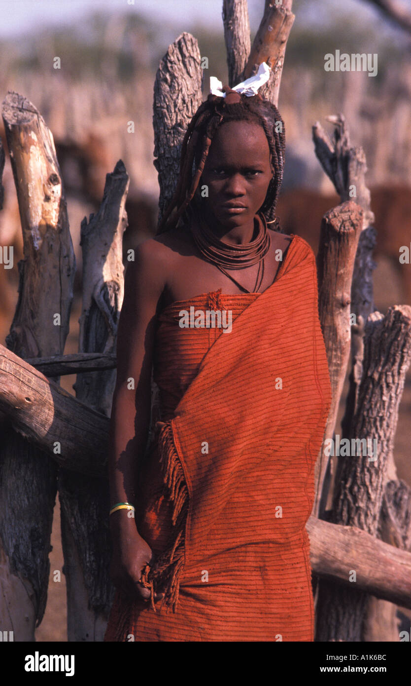 Himba woman and her distinctive hair decoration and adornment village Kaokoveld tribal areas North west of Opuwo Namibia - Stock Image
