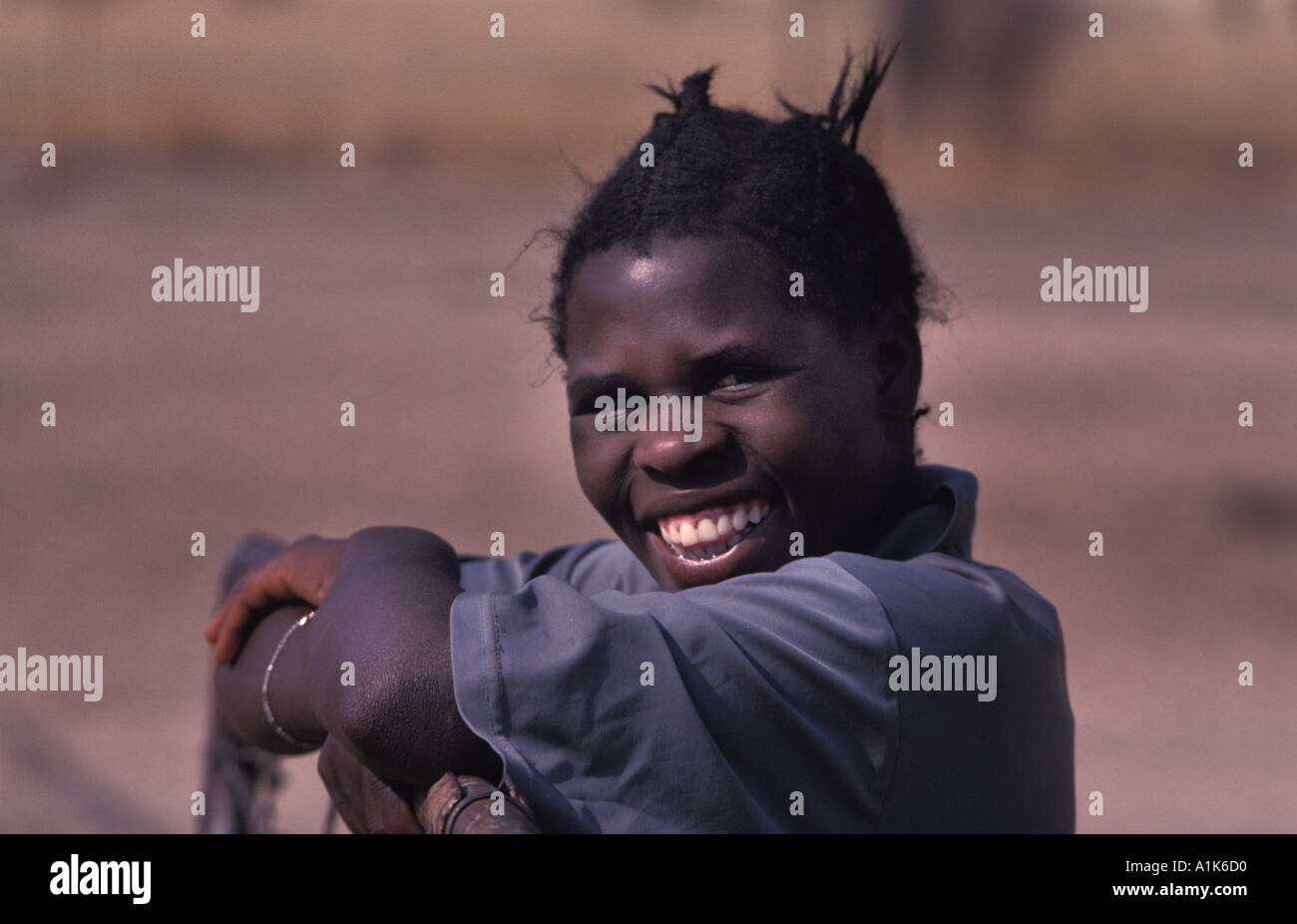 Woman poses for a photo at the MaHerero Day festival Celebrations Okahandja Namibia - Stock Image