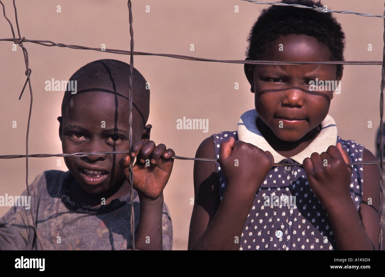 Friendly Herero children pose for a photo Celebrations are held in Okahandja in August each year Okahandja Namibia - Stock Image