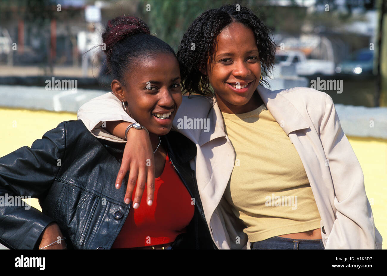 Friendly local girls pose for a photo Maherero Day Celebrations are is held in Okahandja in August each year Namibia - Stock Image