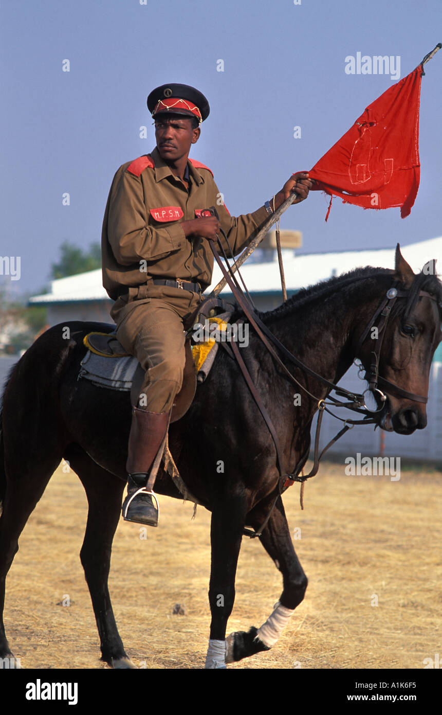 Member of paramilitary style group in uniform and on horseback for the main Herero festival Okahandja Maherero day Namibia - Stock Image