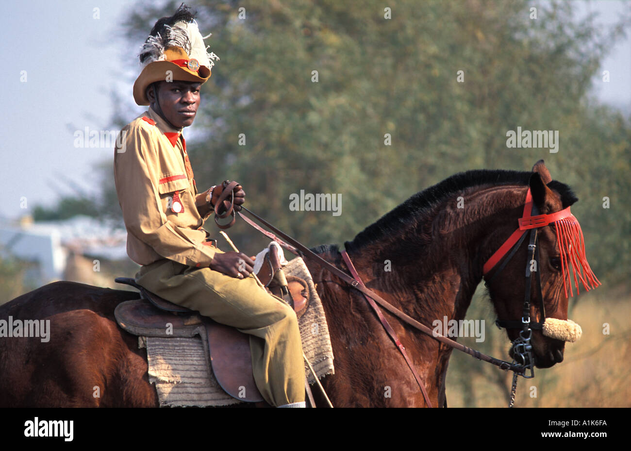 Member of paramilitary style group in uniform and on horseback for the main Herero festival Maherero day Okahandja Namibia - Stock Image