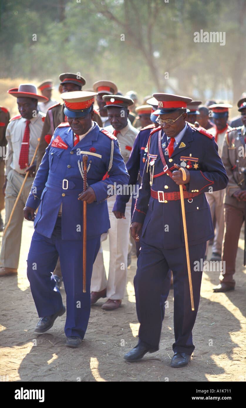 Tribal chiefs of paramilitary style group arriving at the town cemetery Maherero day August Okahandja Namibia - Stock Image