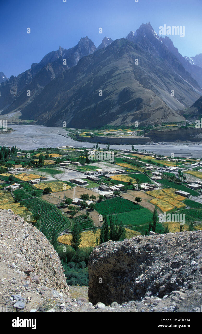 View of Sust surrounding fields and mountains nr Khunjerab Pass Karakoram Highway N Pakistan Stock Photo