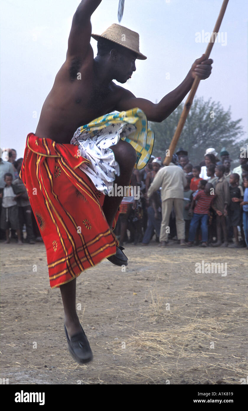 Tribal dancer performs in front of a crowd MaHerero Day festival Okahandja Namibia - Stock Image