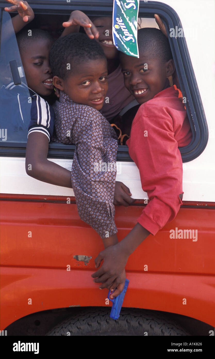 Local children in a playful mood onboard public transport People flock to the MaHerero Day festival Okahandja Namibia - Stock Image