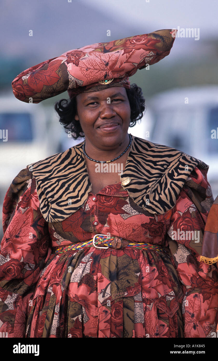 Friendly Herero woman wearing traditional dress in procession for the Ma Herero Day Parade August Okahandja Namibia - Stock Image