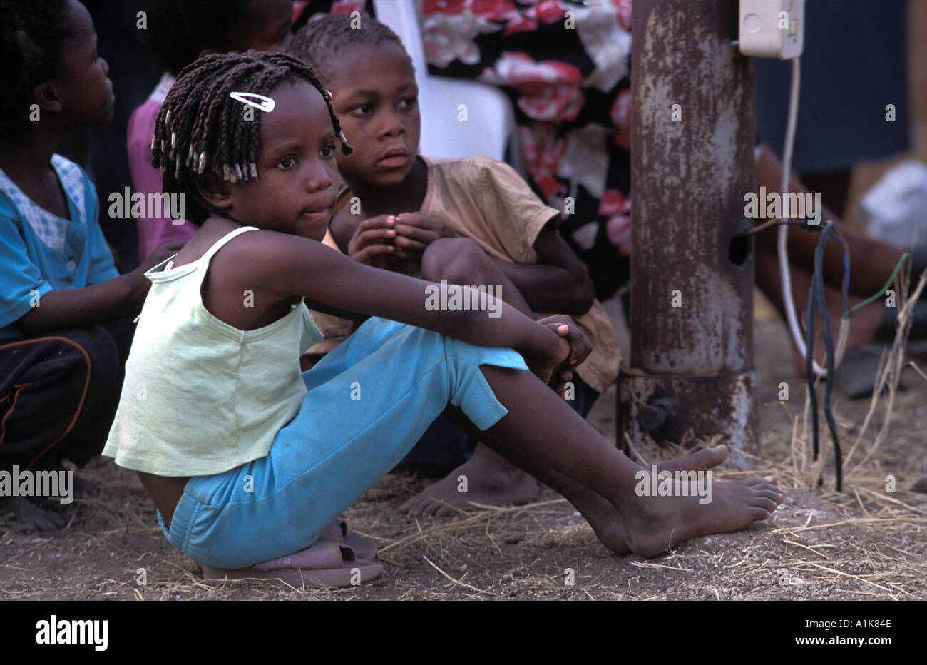 Young Herero children watching the festivities MaHerero Day festival Okahandja August each year Namibia - Stock Image