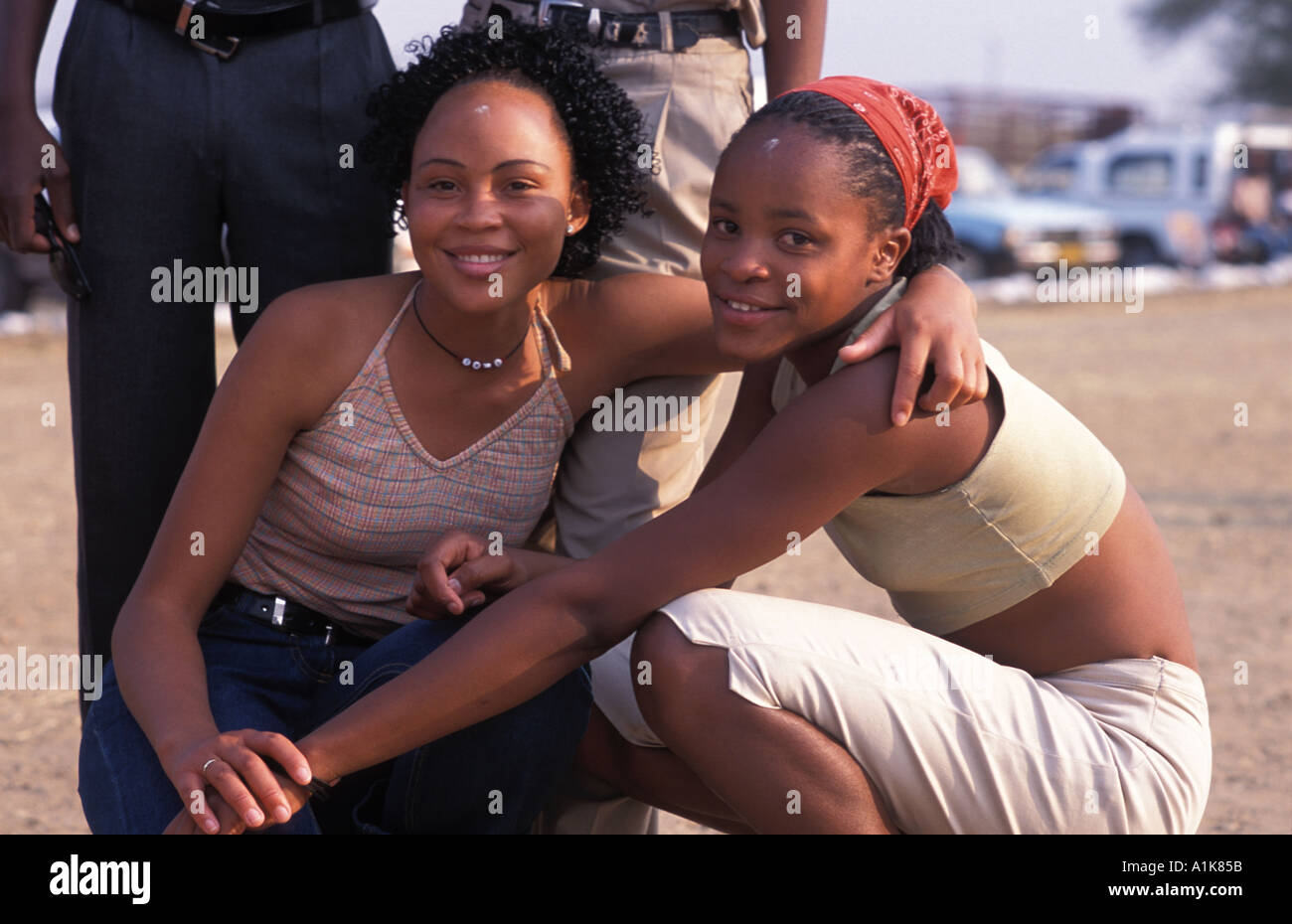 Friendly local girls pose for a photo People flock to the MaHerero Day festival August Okahandja Namibia - Stock Image