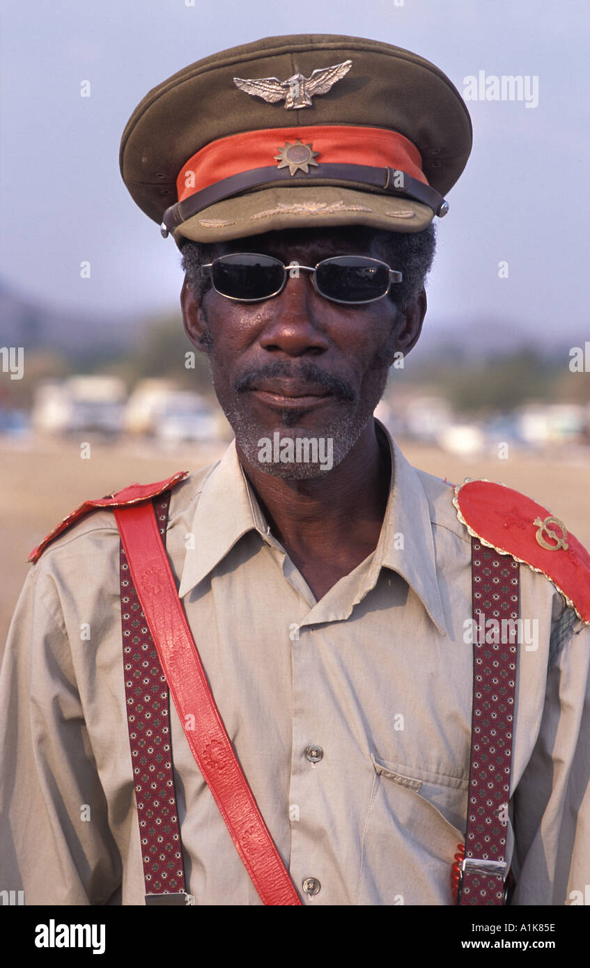 Member of paramilitary style group in uniform for the main Herero festival Maherero day August Okahandja Namibia - Stock Image