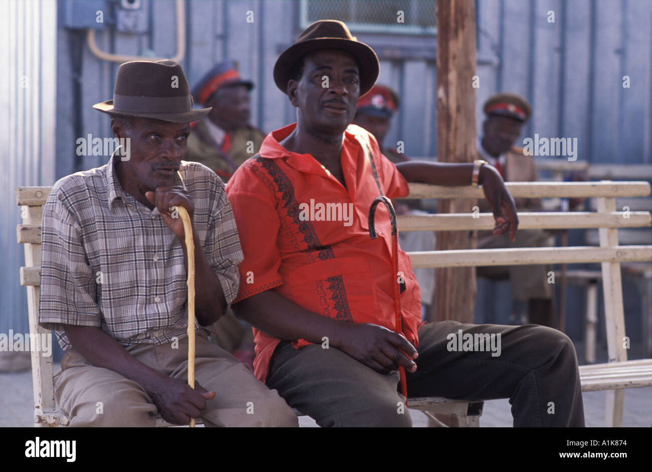 Elderly Herero men resting Celebrations are is held in Okahandja in August each year Okahandja Namibia - Stock Image
