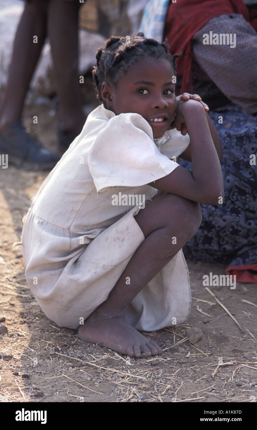 Herero girl watching the festivities poses for a photo Celebrations are is held in Okahandja in August Okahandja Namibia - Stock Image