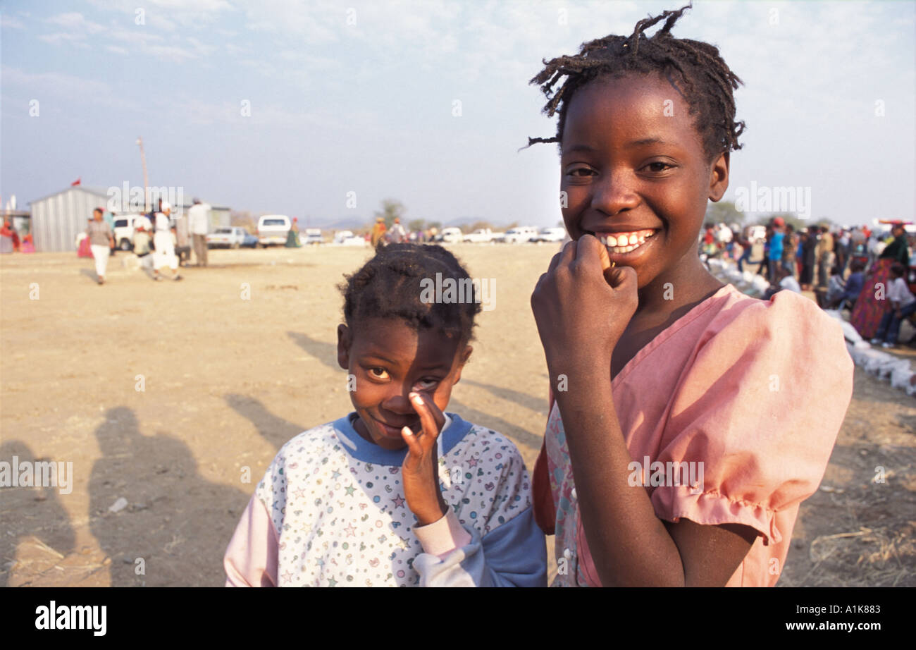 Herero girls pose for a photo MaHerero Day festival Celebrations are is held in Okahandja in August each year Namibia - Stock Image