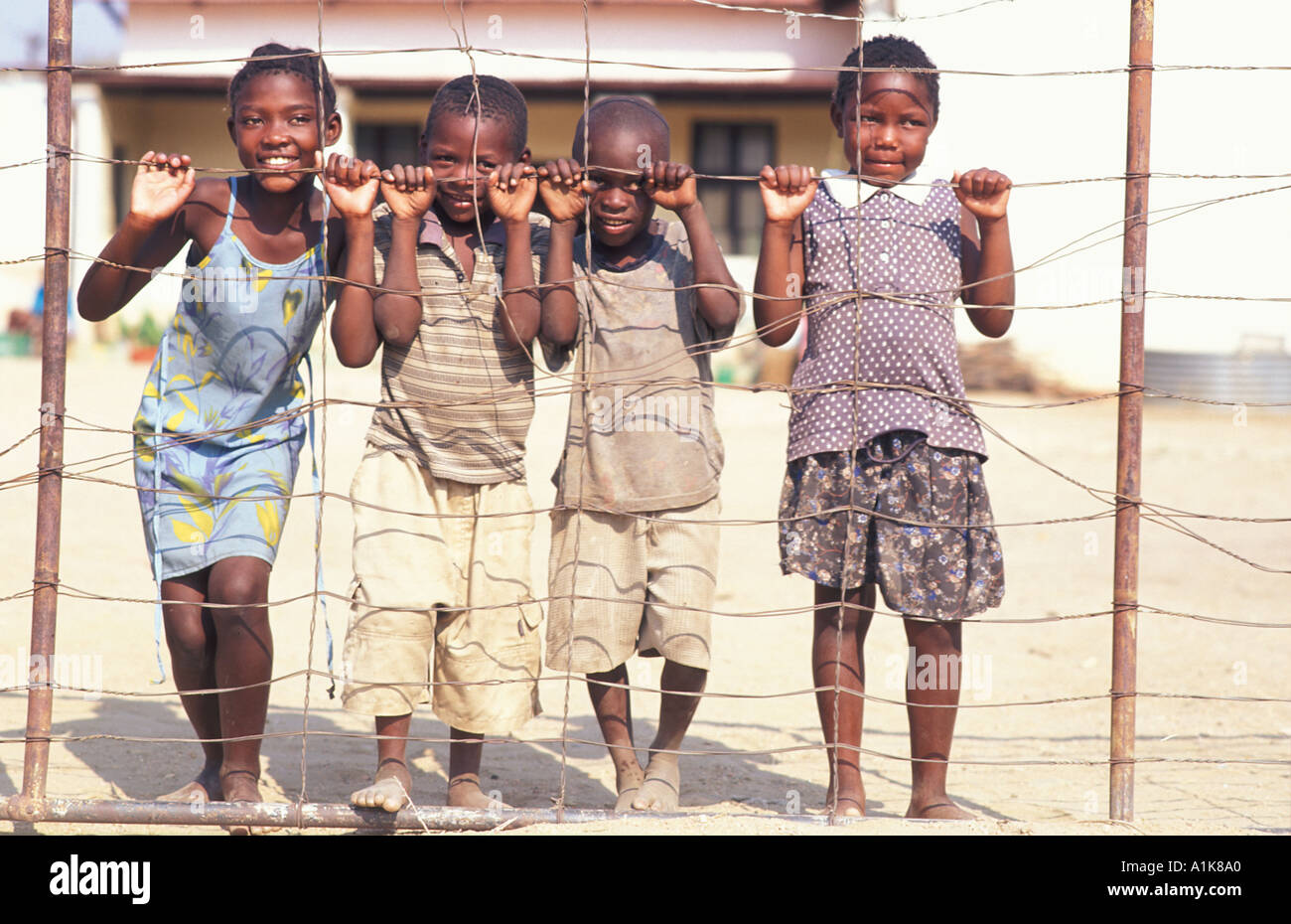 Herero children pose for a photo People flock to the MaHerero Day festival Last weekend in August Okahandja Namibia - Stock Image