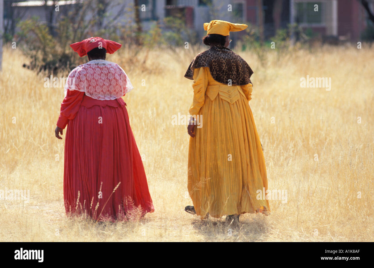 Herero women wearing traditional dress in procession for the Ma Herero Day Parade August Okahandja Namibia - Stock Image
