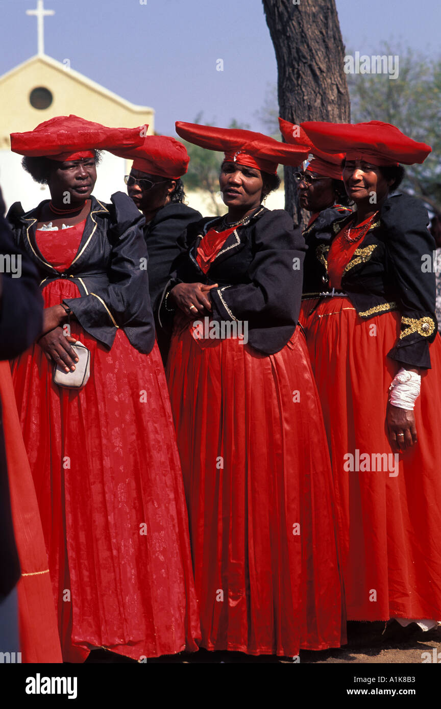 Herero women wearing traditional dress in procession for the Ma Herero Day Parade August Okahandja Namibia Stock Photo