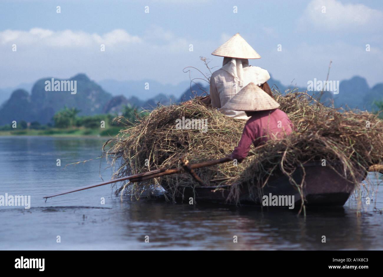 Travelling by fully laden sampan Perfume Pagoda river route near Hanoi Vietnam - Stock Image