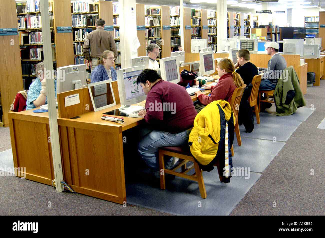 Adults use free internet services at a public library Stock Photo